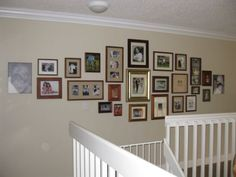 My family photo wall display.  I chose to use all gold and brown wood tones, with the exception of the two unframed canvas prints.  I have found that the overall shape is easily tweaked if I decide I want to add a couple more frames here and there.