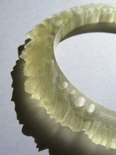 Mitchell Whitelaw's Weather Bracelet is a stunning piece of wearable art. The 3D print visualizes one year of the weather data in Canberra. The outer edge is determined by the daily minimum and maximum temperatures. The holes indicate rainfall. I love this piece, both the look of it and its concept.