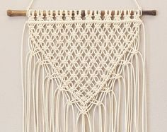 Macramé wall hanging or window curtain: I designed this piece for a custom door window covering, but liked it as a hanging, too. Add a Boho inspired yet classy design to any wall with this macramé wall hanging. Lovingly handmade by me on our Florida horse farm. From modern to traditional, urban to bohemian, macramé blends with any décor. Ready to ship. ◘ Size: Bamboo rod : 26 - 29 (pictured, or order without a rod) Macramé hanging measures 22 wide and 50 at the longest. I can adjust the s...