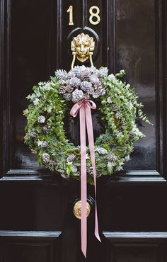Holiday Decor | Outdoor Holiday Decor | Holiday heath | DIY Wreath | Elegant Holiday Decor | Beautiful holiday wreath on a gorgeous black front door. Absolutely love the long pink satin bow and the cluster of pinecones at the top!