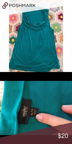 Mossimo Supply Co teal top Gorgeous teal colored sleeveless top. Seriously this color is amazing in person!  Pretty rouged neckline and loose bodice. Bought, removed the tags, washed and never worn. This would be perfect for church or the office. Mossimo Supply Co Tops Blouses
