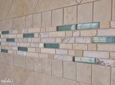 Pretty tile with glass for a shower in a coastal or beach house
