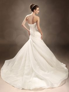 This strapless organza wedding dress by Sophia Tolli features lace appliqués dusted with decadent scattered beading and a strapless sweetheart neckline. Wedding Dress Pictures, Wedding Dresses Photos, Wedding Bridesmaid Dresses, Wedding Dress Styles, Designer Wedding Dresses, Bridal Dresses, Wedding Attire, Fit And Flare Wedding Dress, Perfect Wedding Dress