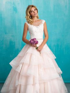Have you been dreaming about a tiered wedding dress? We can't get enough of the 9321 from Allure Bridals – it has a subtle pink hue and a skirt made up of full, frothy tiers. It's the ideal gown for brides hunting for a princess wedding dress.
