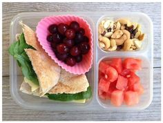 Today's school lunch is whole-wheat pitas (stuffed with organic hummus, cheddar and spinach), grapes, watermelon, and homemade trail mix.
