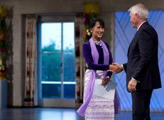 MY ICON,AUNG SAN SU KYI, RECEIVING NOBLE PRIZE FOR PEACE 21 YEARS AFTER SHE WAS FIRST AWARDED,AS SHE WAS UNDER HOUSE ARREST FOR STANDING UP AGAINST THE MILITARY REGIME. GOD DOES JUSTICE HERE !