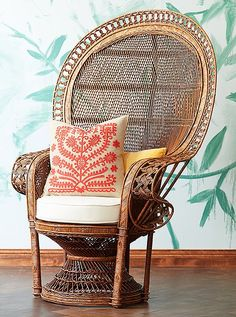 This wicker peacock chair is made of woven rattan in a natural honey hue that projects tropical warmth.