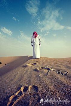 man standing in the desert