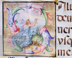 Initial capital letter S depicting a king rising from the waves, miniature from a medieval antiphonary, manuscript, Italy.
