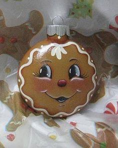 This little guy reminds us of days gone by when Granny used to make spicy ginger bread cookies to hang on the tree to decorate for that special day. Not many lasted all the way to Christmas but the memories will last forever. These are made of glass and a Gingerbread Ornaments, Gingerbread Decorations, Painted Christmas Ornaments, Hand Painted Ornaments, Christmas Gingerbread, Noel Christmas, Christmas Balls, Gingerbread Men, Lightbulb Ornaments