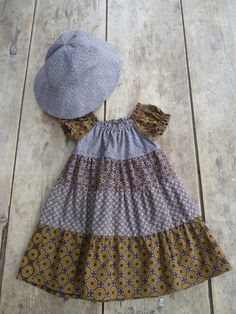 Infant's dress and sun hat made of Shweshwe African Inspired Fashion, African Fashion, Modest Outfits, Kids Outfits, Little Girl Dresses, Girls Dresses, Love Fashion, Kids Fashion, Shweshwe Dresses