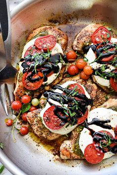 Chicken breasts with mozzarella cheese, tomatoes, fresh herbs and balsamic glaze.