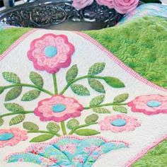 Fancy Flowers: Floral Appliqué Wall Quilt Pattern Designed and Machine Quilted by ERIN RUSSEK, patterned in McCall's Quilting May/June 2014