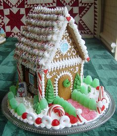 Gingerbread house with red quilt in background