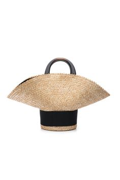 Throw all your beach necessities into this woven statement bag from Eugenia Kim.