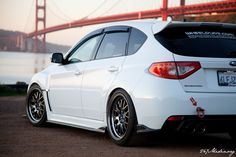 Love the stance and the white/black contrast with the body color and wheels. Subaru Impreza WRX STI