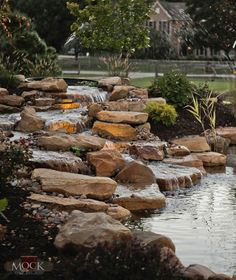 Backyard waterfalls water garden koi pond and streams for Koi pond maintenance near me