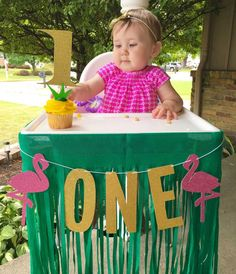Evie's First Birthday Party - Hawaiian Luau style! This custom flamingo banner and cake topper were a perfect touch!