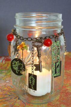 Love this! Altar Jar - hang charms related to whatever you are lighting the candle for. You can keep using a large candle for many different seasons without changing the color.
