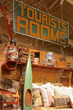 Love the old toboggan as a shelf over the bed. Going to do this! Lodge Look, Lodge Style, Log Home Interiors, Camping Theme, Camping Style, Vintage Cabin, Lake Cabins, Lodge Decor, Cozy Cabin