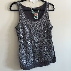 """❄️SALE❄️Express Sparkly Top Preowned in excellent condition top by Express. The front part of the top is lace-like with sequin. The back part is 60% cotton, 40% modal. Length is 24"""" Express Tops Tank Tops"""