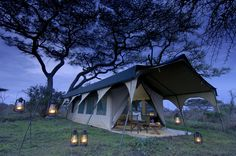 Glamping tent - we would need to rent a U-Haul to get tent and furnishings to the camp site, but I LOVE this!