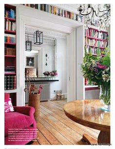 I love bookshelves and have a few dotted around my home above the doors like in this picture - such clever storage!