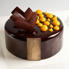 Chocolate hazelnut mango entremet by Pastry Chef Antonio Bachour Baked Strawberries, Chocolate Strawberries, Cupcakes, Cupcake Cakes, Bundt Cakes, Fancy Desserts, Delicious Desserts, Patisserie Fine, Decoration Patisserie