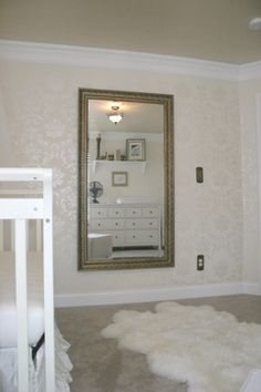 White and gold girls nursery, A mostly white with gold accents nursery - damask walls, bronze and gold details, a white fur rug, all white furniture, and art deco and art nouveau details., Mirror from Kirklands, rug from Ikea., Nurseries Design