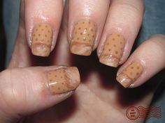 I used Zoya Helen as a base, with Urban Outfitters Nude 3 to highlight, and Zoya Helen and Zoya Dea to shade and for the dots. (as the perforated holes in the plastic type of bandages) Topped it all off with 2 coats of Seche vite top coat.