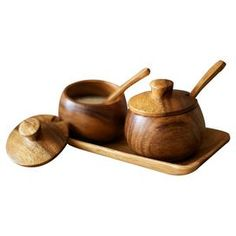 Seven-piece handcrafted eco-friendly acacia wood condiment set.   Product: 2 Lidded canisters, 2 spoons, and one trayConstruction Material: Acacia woodColor: NaturalFeatures: Hand-craftedDimensions: 3.5'' H x 8'' W x 4'' D (overall)Cleaning and Care: Food safe. Clean with warm soapy water.