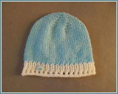 """Elgin Baby Hat 0 - 3 months Elgin Baby Hat To fit a baby of around 0 – 3 months  Width:  6 """" (15cm) 12"""" (30cm) all around  Height:  6 """" (15cm)  DK (8ply) yarn – or any y"""