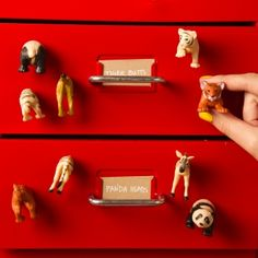 DIY animal magnets in just a few steps. We chose plastic animals, but just about any small toy will do!
