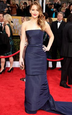Jennifer Lawrence in Christian Dior Haute Couture- She has pneumonia, but the actress didn't let that stop her from walking the red carpet to show off her beautiful midnight blue Dior gown. B+