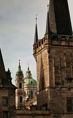 Lesser Town Tower of Charles Bridge and St.Nicolas chuirch, Prague, Czechia