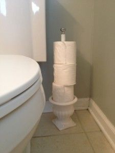 Toilet Paper Holder From a Pot and a Dowel