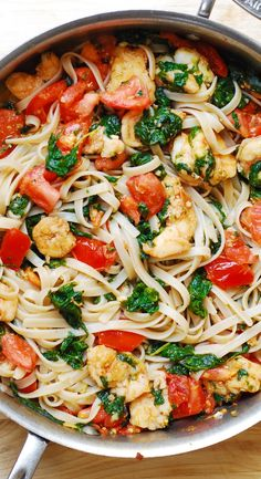 Shrimp, fresh tomatoes, and spinach with fettuccine pasta in garlic butter sauce. Very Italian recipe!