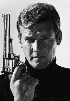 Roger Moore as James Bond © Terry O'Neill Terry O Neill, Morrison Hotel, Celebrity Photography, Celebrity Portraits, Roger Moore, Bond Girls, Music Artists, Movie Stars, Photos