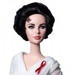"""Una delle più grandi case produttrici di giocattoli, omaggia la bellissima attrice Elizabeth Taylor con una delle sue bambole più famose al mondo.Una Barbie da collezione che la riproduce nello storico film """"La gatta sul tetto che scotta""""."""