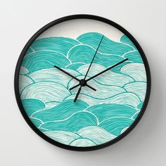 The Calm and Stormy Seas Wall Clock by Pom Graphic Design  - $30.00