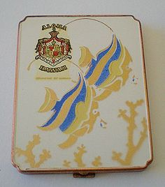 This is a hard to find, souvenir powder compact from Hawaii. The back is plain, white enamel. The front has a Royal Hawaiian crest decal, Aloha Lipstick Case, Lipstick Holder, Hawaiian Art, Vintage Hawaiian, Ladies Accessories, Dresser Sets, Vintage Makeup, Vintage Purses, White Enamel