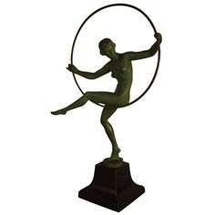Art Deco Hoop Dancer Statue by Briand | From a unique collection of antique and modern sculptures at https://www.1stdibs.com/furniture/decorative-objects/sculptures/