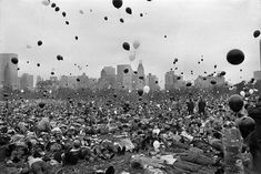Supporters of the Vietnam moratorium lie in the Sheep Meadow of New York's Central Park as hundreds of black and white balloons float skyward. A spokesman for the moratorium committee said the black balloons represented Americans who died in Vietnam under the Nixon administration, and the white balloons symbolized the number of Americans who would die if the war continued, November 14, 1969.  Photo credit: AP / J. Spencer Jones Central Park, New York Central, Vietnam Protests, Black And White Balloons, Vietnam War Photos, North Vietnam, Manhattan New York, Iconic Photos, Us Marines
