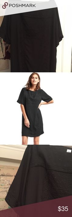 Gap XXL embroidered black shift dress I own the white version of the dress in XL.  I purchased the XXL  by accident on poshmark.  This XXL is a very generous fit.  If you wear XL in recent Gap clothes, this is going to be too big. GAP Dresses Midi