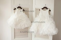 What about this in navy blue?? Peach Pink/Ivory Organza Ruffle Ball Gown Flower by knothouses