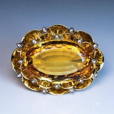 made in Moscow in the 1930s An Art Deco 14K gold brooch features a huge and very rare Russian precious Imperial topaz from the Ural Mountains set in a scal