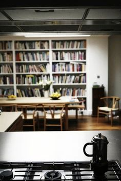 Books in the Kitchen  http://www.apartmenttherapy.com/books-in-the-kitchen-171324