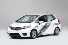 A modified 2015 Honda Fit from Tjin Edition was voted as the Fan Favorite in the competition and was showcased in Honda's booth at SEMA. Honda Jazz, Honda S, Honda Civic, Grom Motorcycle, 2015 Honda Fit, Honda Grom, Racing Seats, Roll Cage, Dream Cars