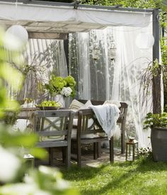 note the canvas? drop cloth? sunbrella weather tolerant fabric? awning / cover for pergola