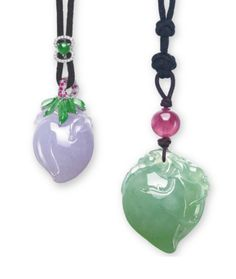 TWO JADEITE PENDANTS  EACH SUSPENDING A JADEITE PEACH, THE LARGER PEACH OF LIGHT GREEN COLOUR AND VERY GOOD TRANSLUCENCY, TO THE TOURMALINE BEAD SURMOUNT AND FINE BLACK CORD; THE SMALLER PEACH OF SOFT LAVENDER COLOUR AND VERY GOOD TRANSLUCENCY, ENHANCED BY BRIGHT GREEN JADEITE LEAVES, TO THE DIAMOND AND PINK SAPPHIRE SURMOUNT, JOINED TO A LENGTH ADJUSTABLE BLACK CORD